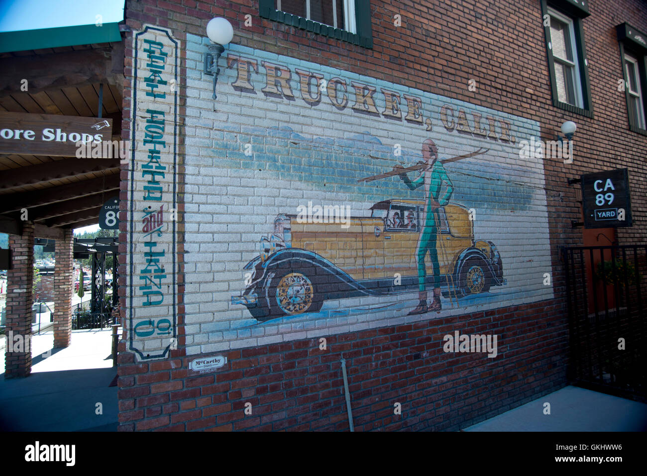 Vintage marketing sign on brick wall in Truckee, California - Stock Image