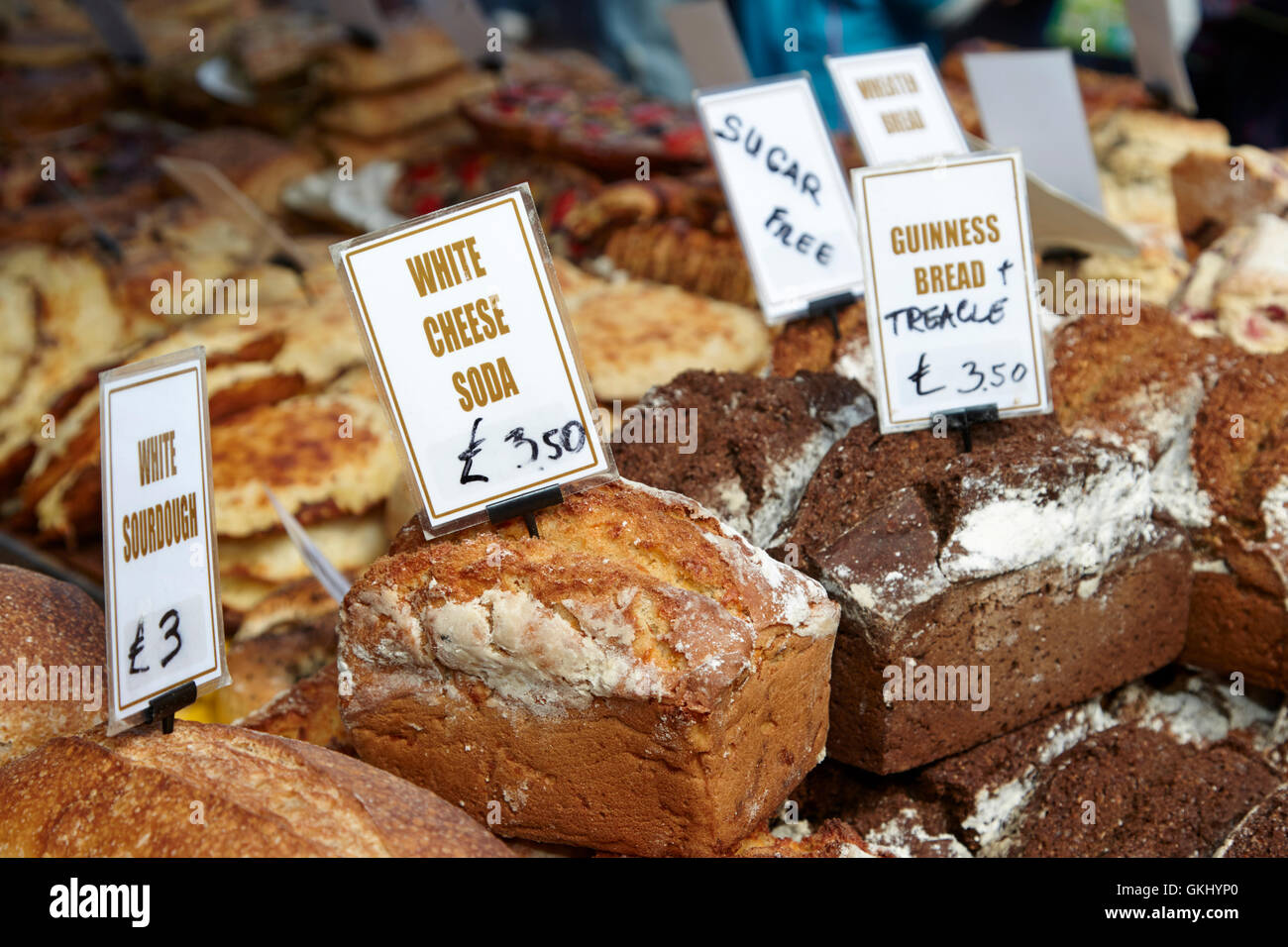 handmade irish artisan breads on a stall at a food market in northern ireland - Stock Image