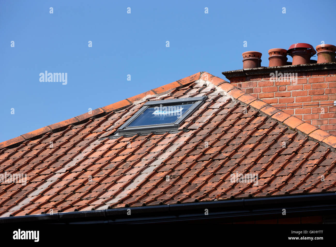 keylite roof window in a loft conversion of an older house - Stock Image