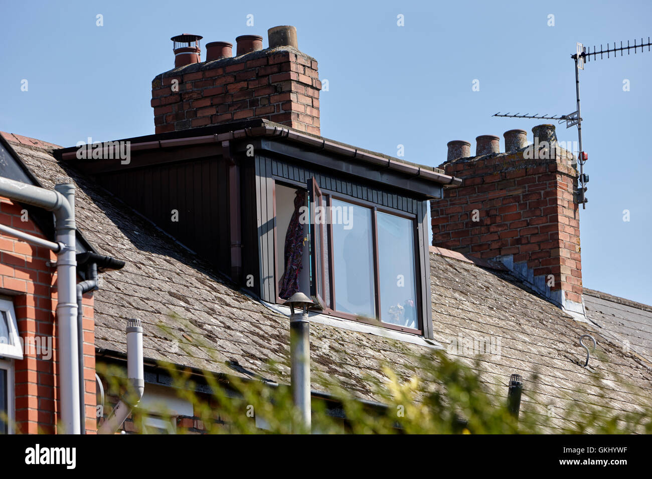flat roof loft conversion window in a house in the uk - Stock Image