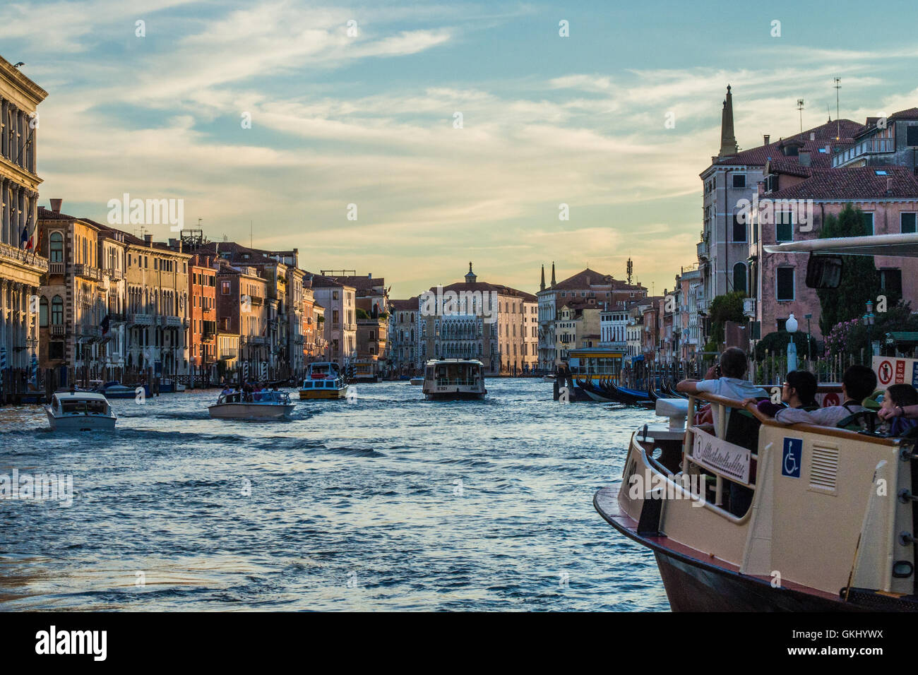 Passengers on a Vaporetto (Water Bus) gazing down the Grand Canal, Venice, Veneto province, Italy. - Stock Image