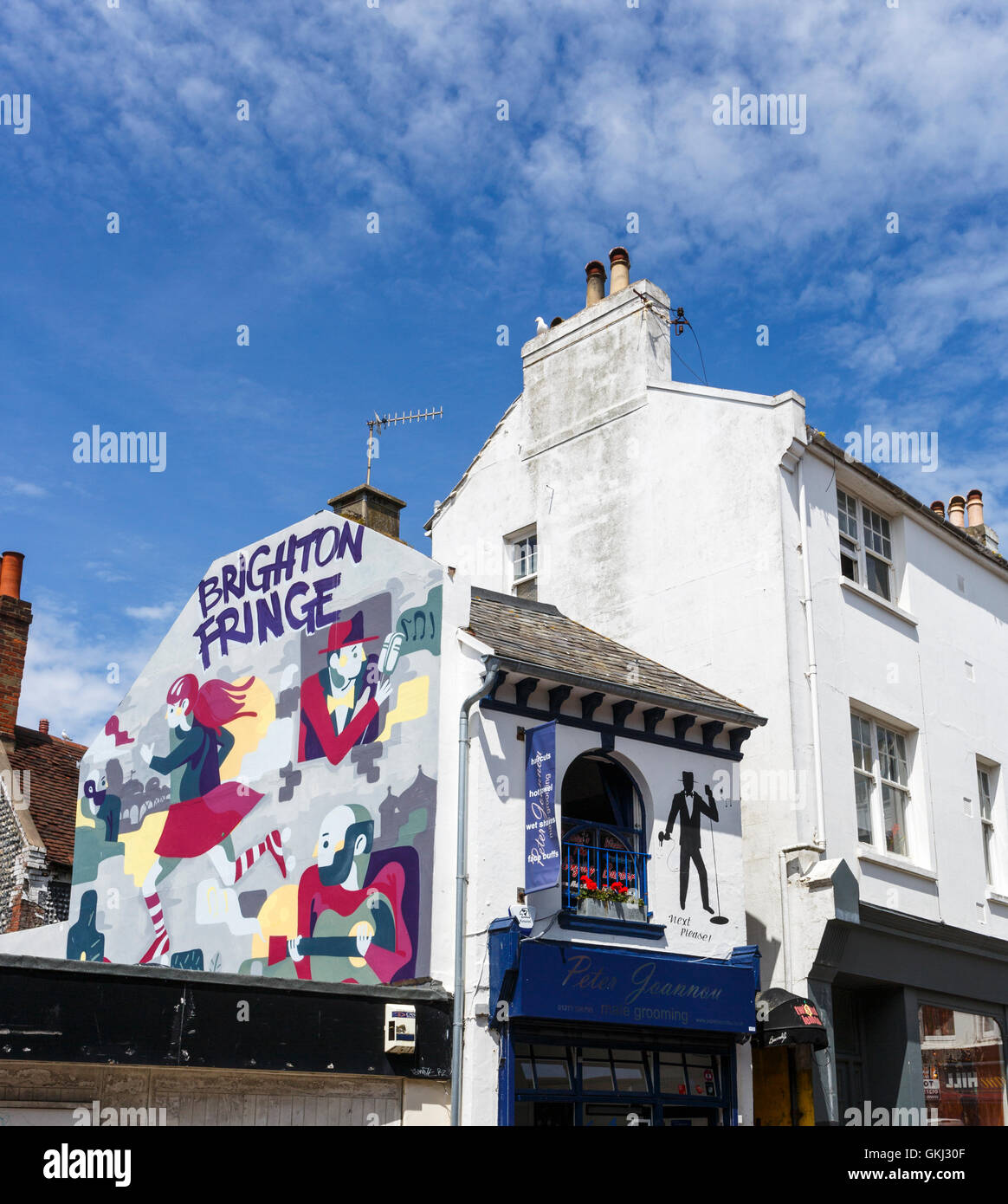 Mural advertising the Brighton Fringe arts festival in The Lanes, Brighton, East Sussex, UK on a sunny summer day - Stock Image