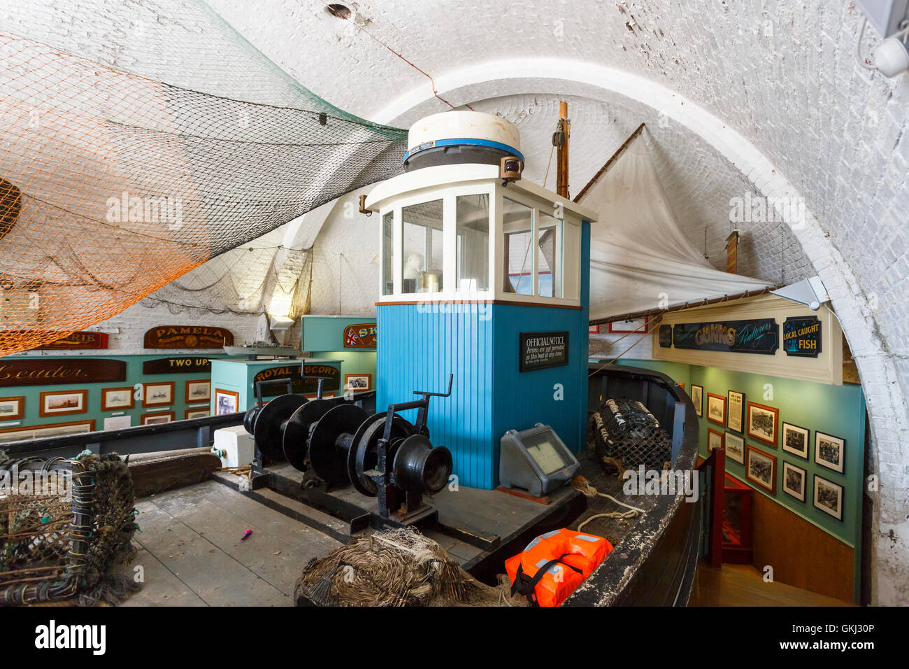 Old fashioned fishing boat on display as an exhibit in the Brighton Fishing Museum, Brighton, East Sussex, UK - Stock Image