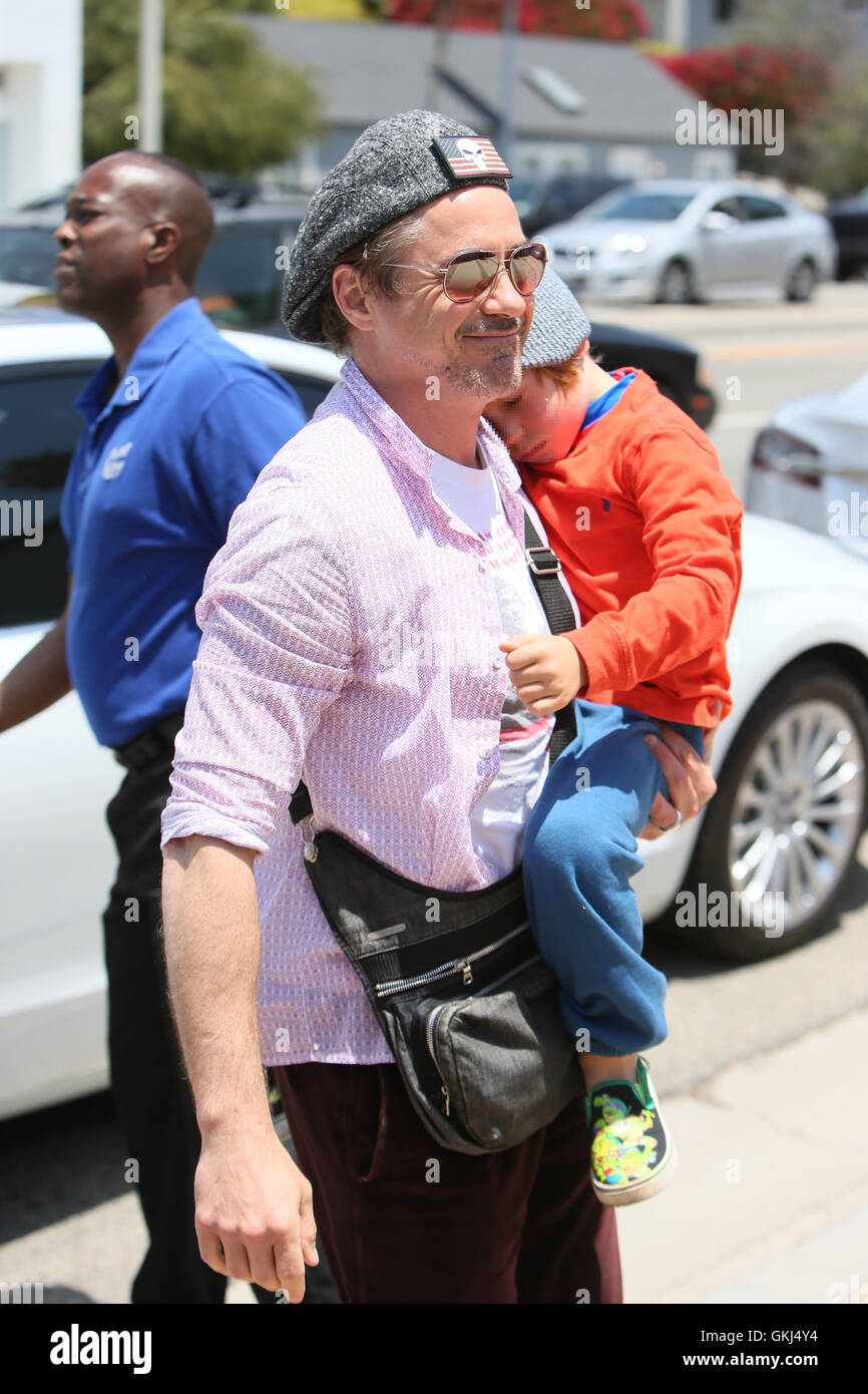7362c2dc1fa8b Robert Downey Jr arrives at Joel Silver s Memorial Day party with his son  Exton Featuring  Robert Downey Jr.
