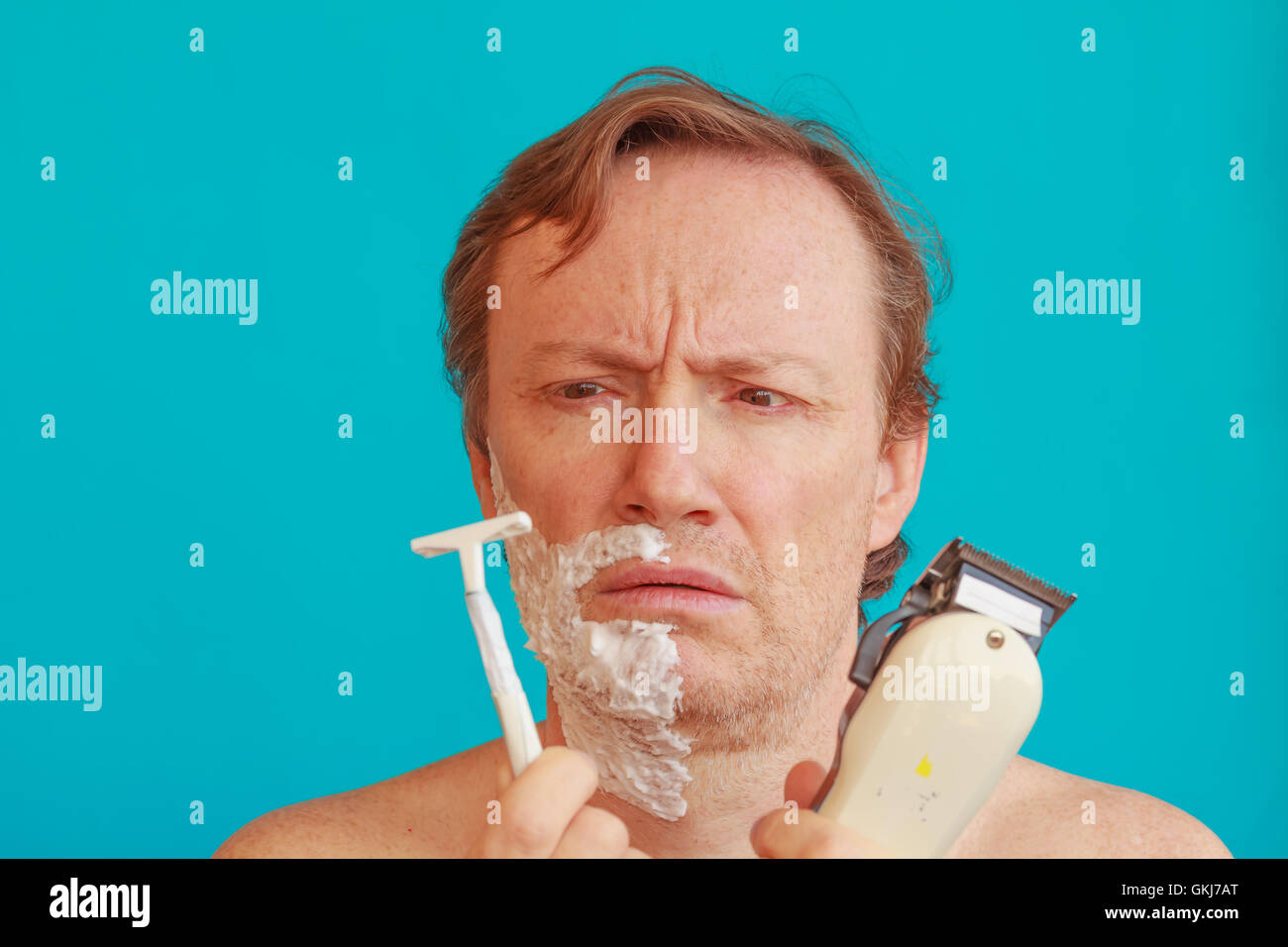 a man to shave must to choose between the razor or razor-blade - Stock Image