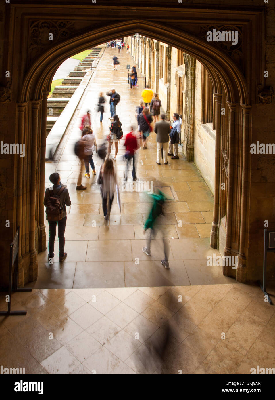 Christ Church Collage Oxford students rushing and hurrying about  using a slow shutter speed - Stock Image