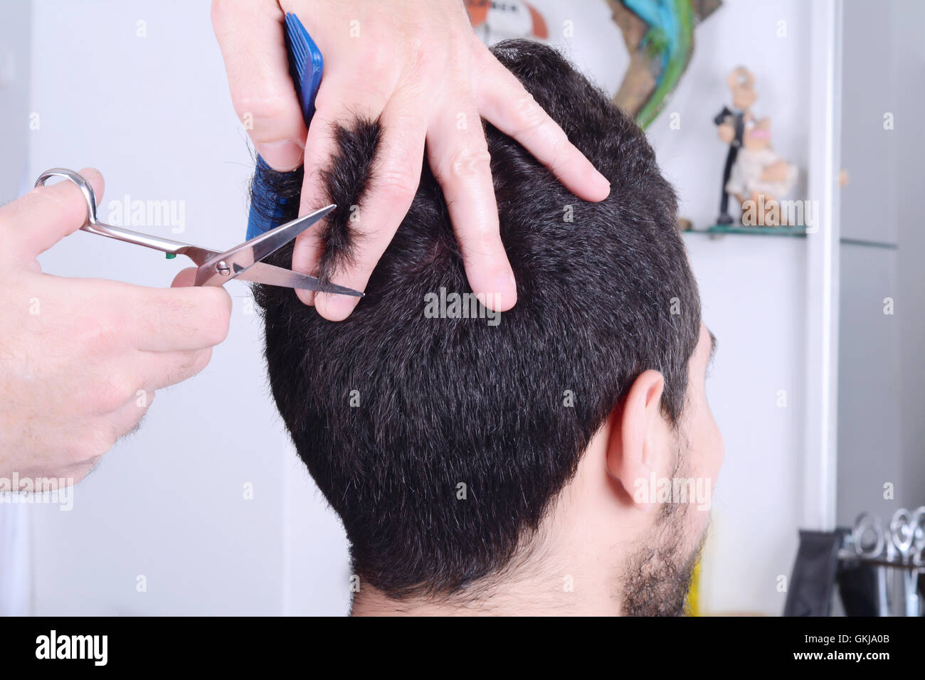 Close Up Of Young Man Having A Haircut With Scissors Stock Photo