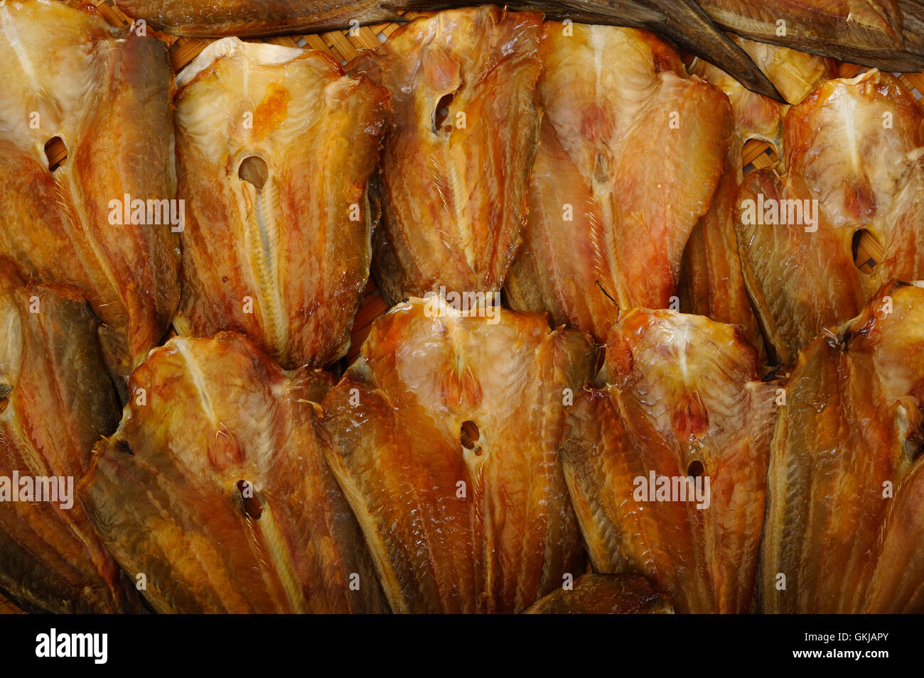 dried salted fish background - Stock Image