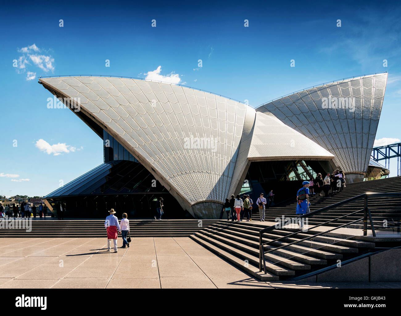 tourists visiting sydney opera house landmark detail in australia on sunny day - Stock Image
