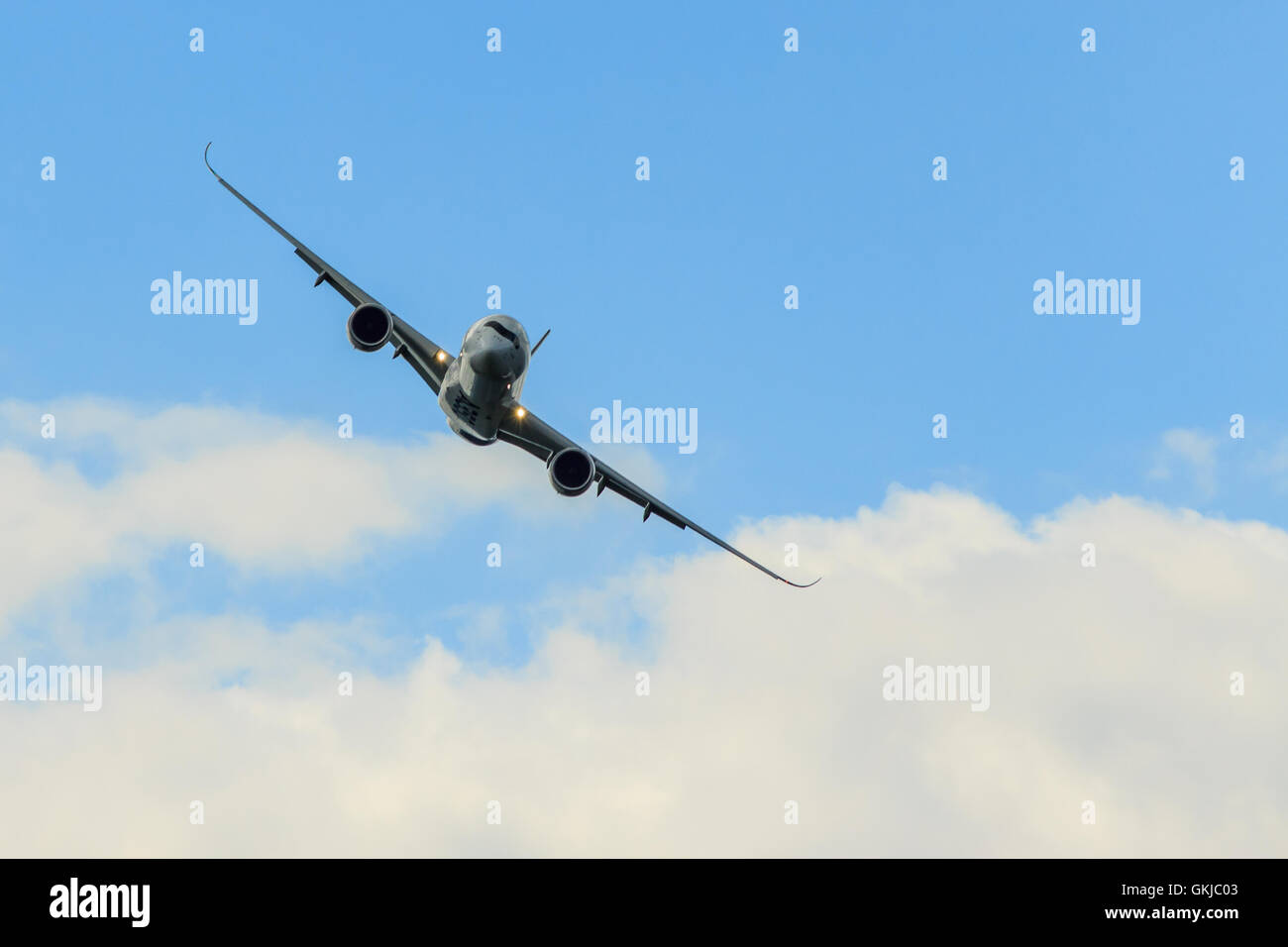 Airbus A350 facing head-on in the clouds - Stock Image