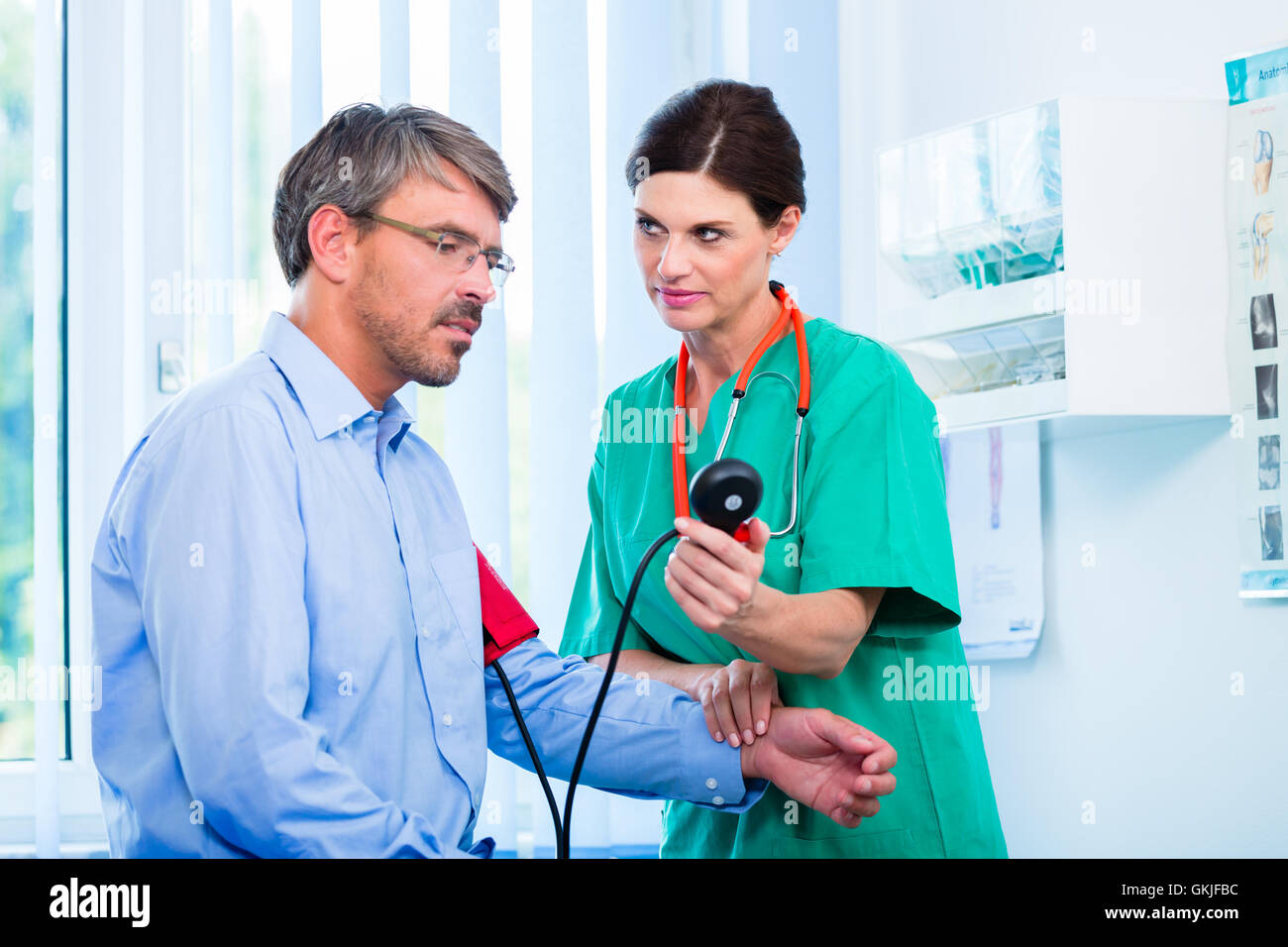 orthopedist examined patient at hand - Stock Image