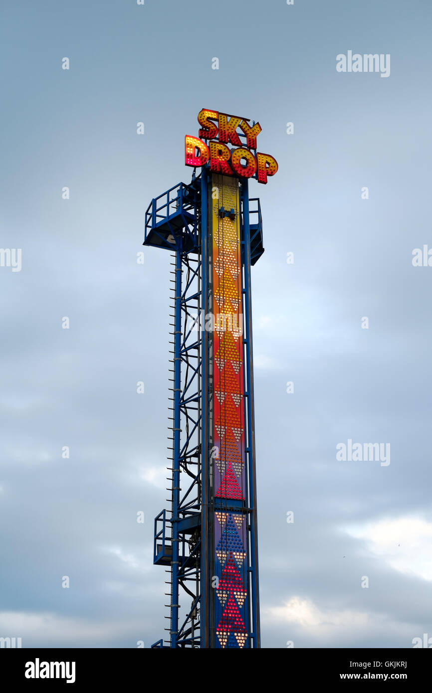 Skydrop ride at funfair in neon - Stock Image