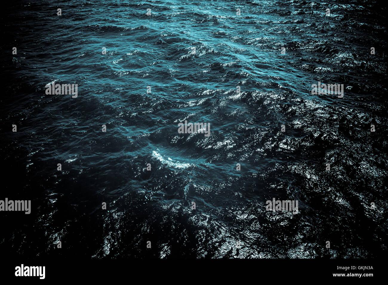 Dark ocean water with moonlight - Stock Image