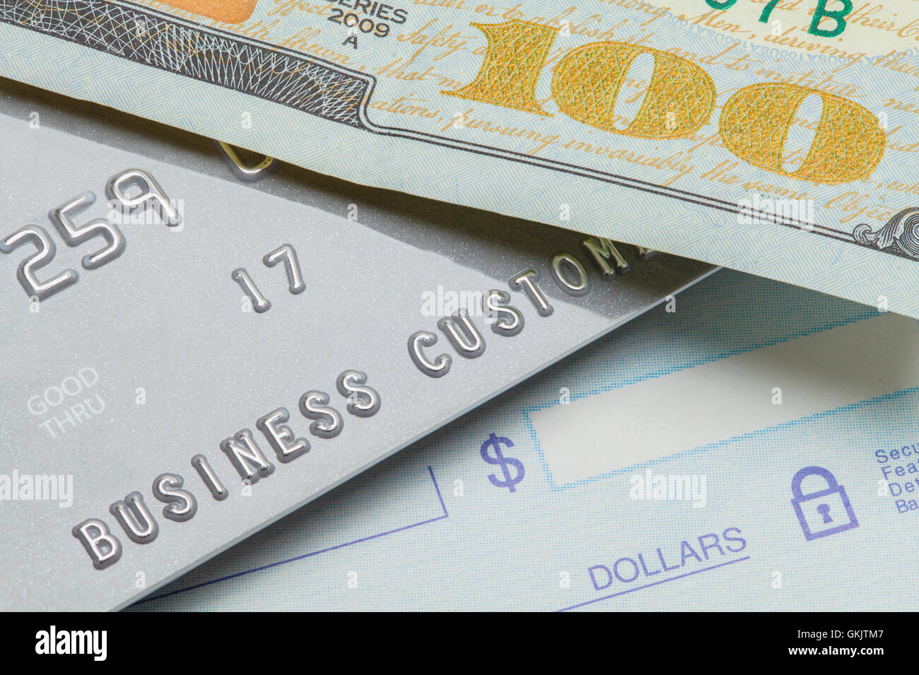 One Hundred Dollar Bill with Credit Card and Bank Check. - Stock Image