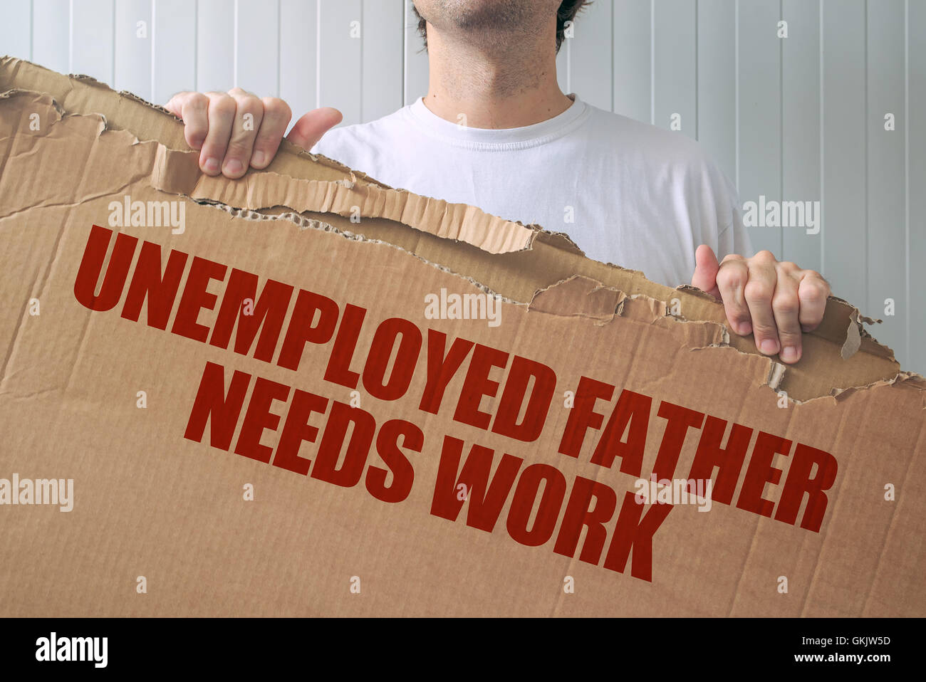 Unemployed father needs work, man holding banner with job seeking title - Stock Image