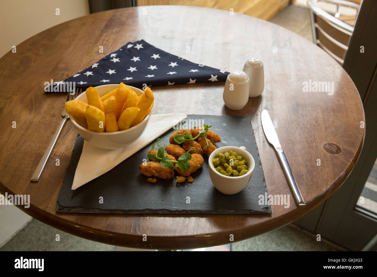 Scampi and chips with peas Stock Photo