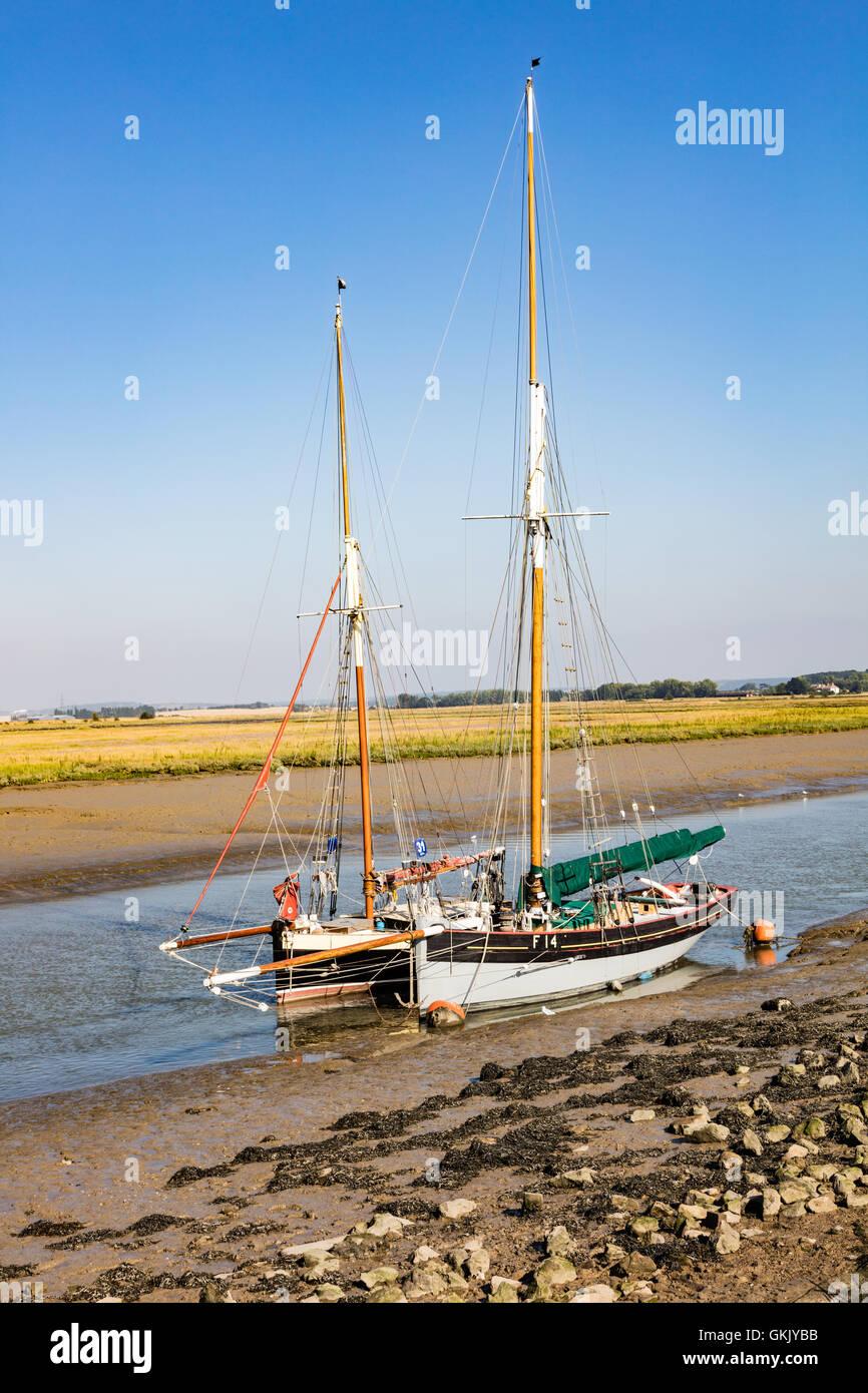 A pair of Smack fishing boats, moored at Oare in Faversham Creek, Faversham, Kent, UK Stock Photo