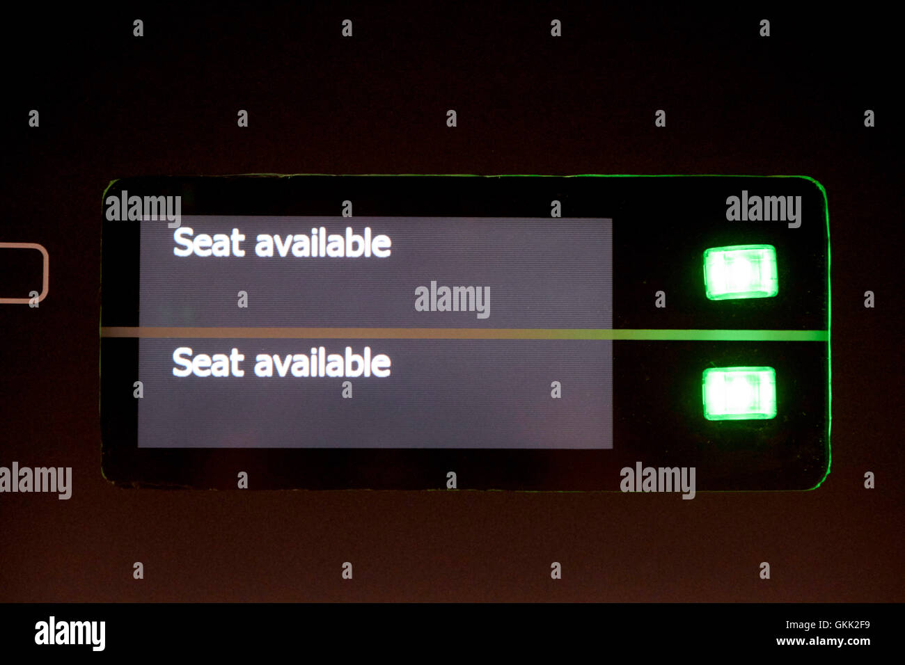 seat available signs on overhead seat reservation screens on a train - Stock Image