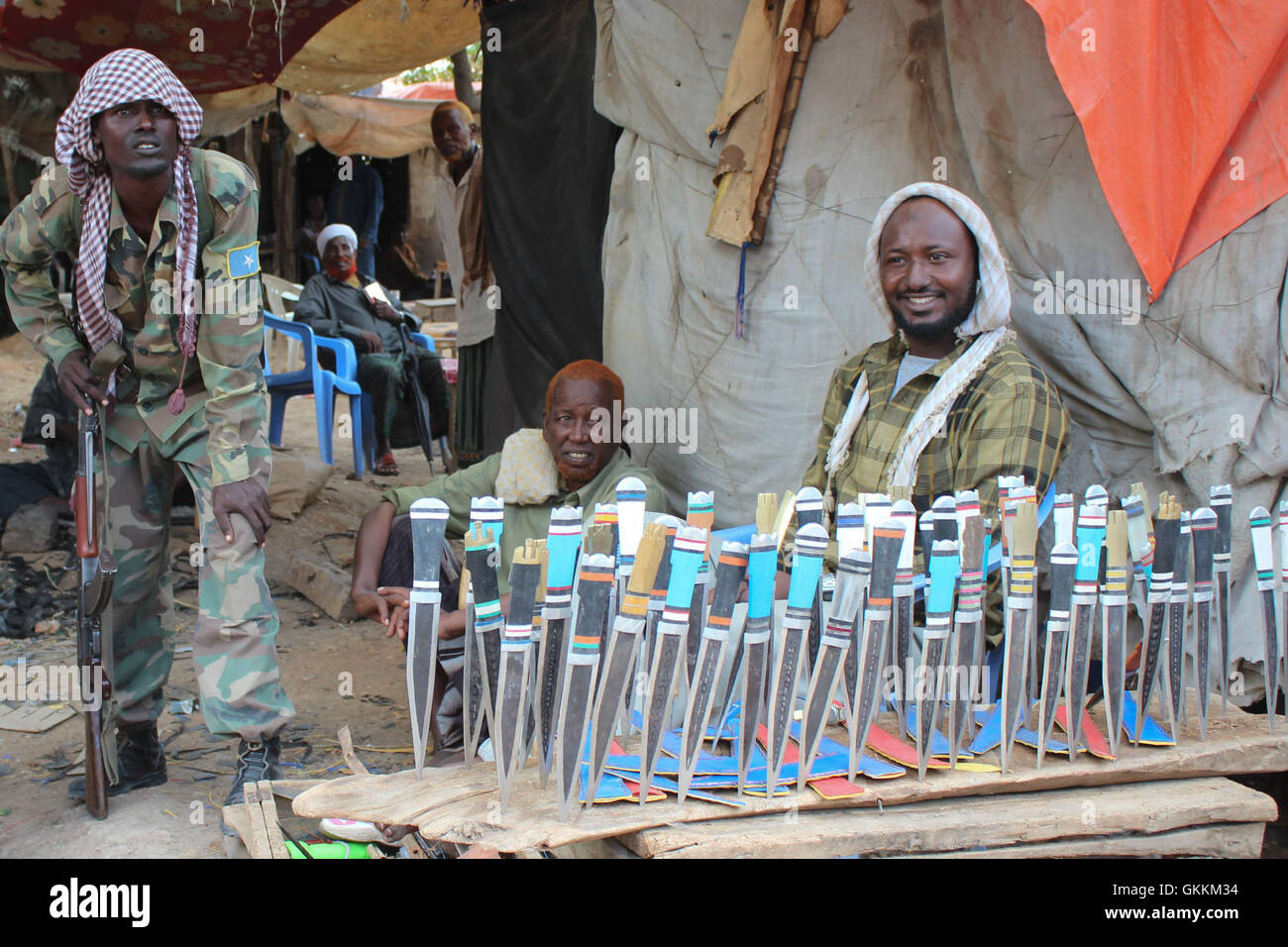 A man sells knives in Baardere market, Somalia. business activities have resumed after the town was captured from Stock Photo