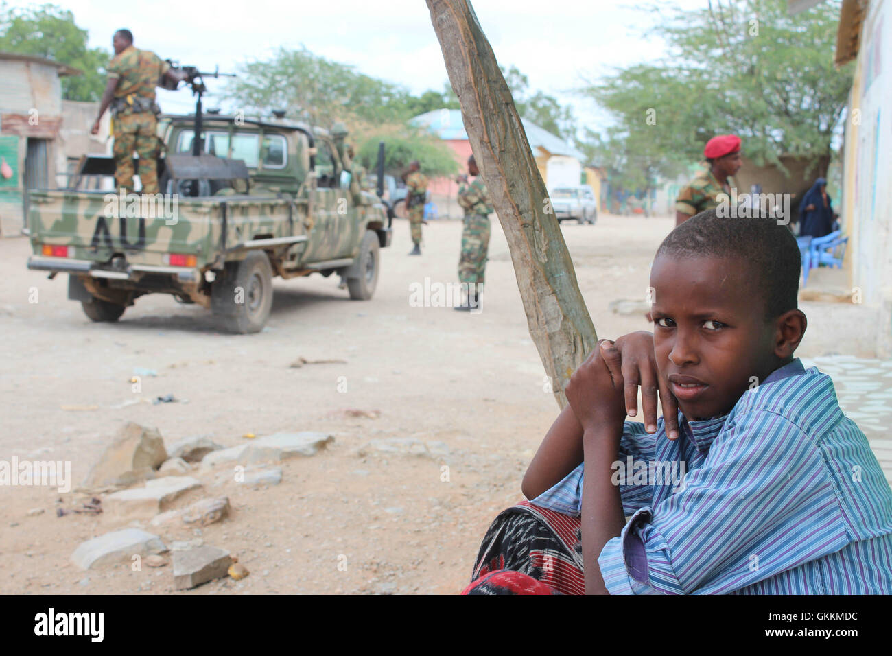 A boy sits outside their home in Baardhere, Somalia after the town was captured from the extremist group Al Shabab, Stock Photo