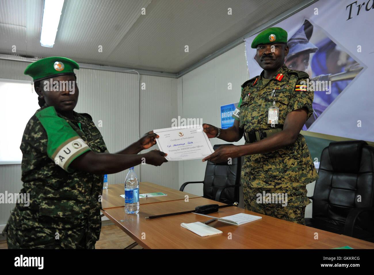Maj. Gen. Nakibus Lakara, the Acting Force Commander of the African Union Mission in Somalia (AMISOM), awards a - Stock Image