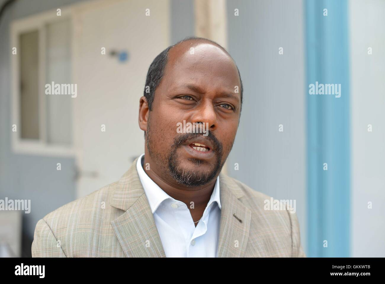 Dr. Omar Abdulle Alasow, the Acting Head of the AMISOM protection, human rights and gender cluster, in an interview - Stock Image