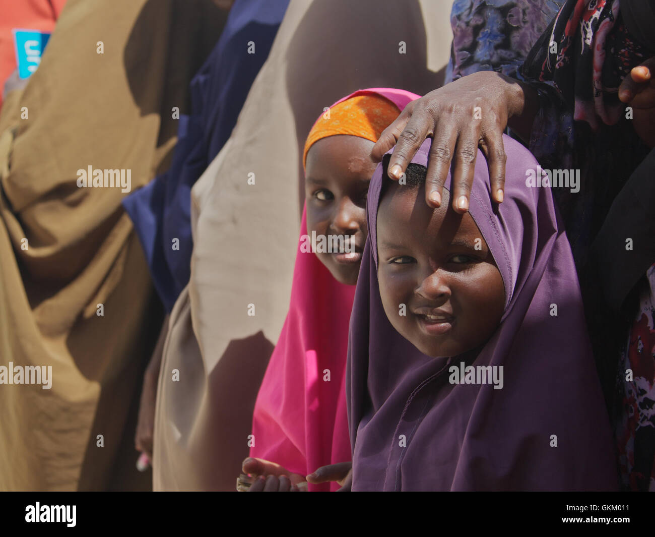 Somali families wait for treatment at the AMISOM Outpatients Department. - Stock Image