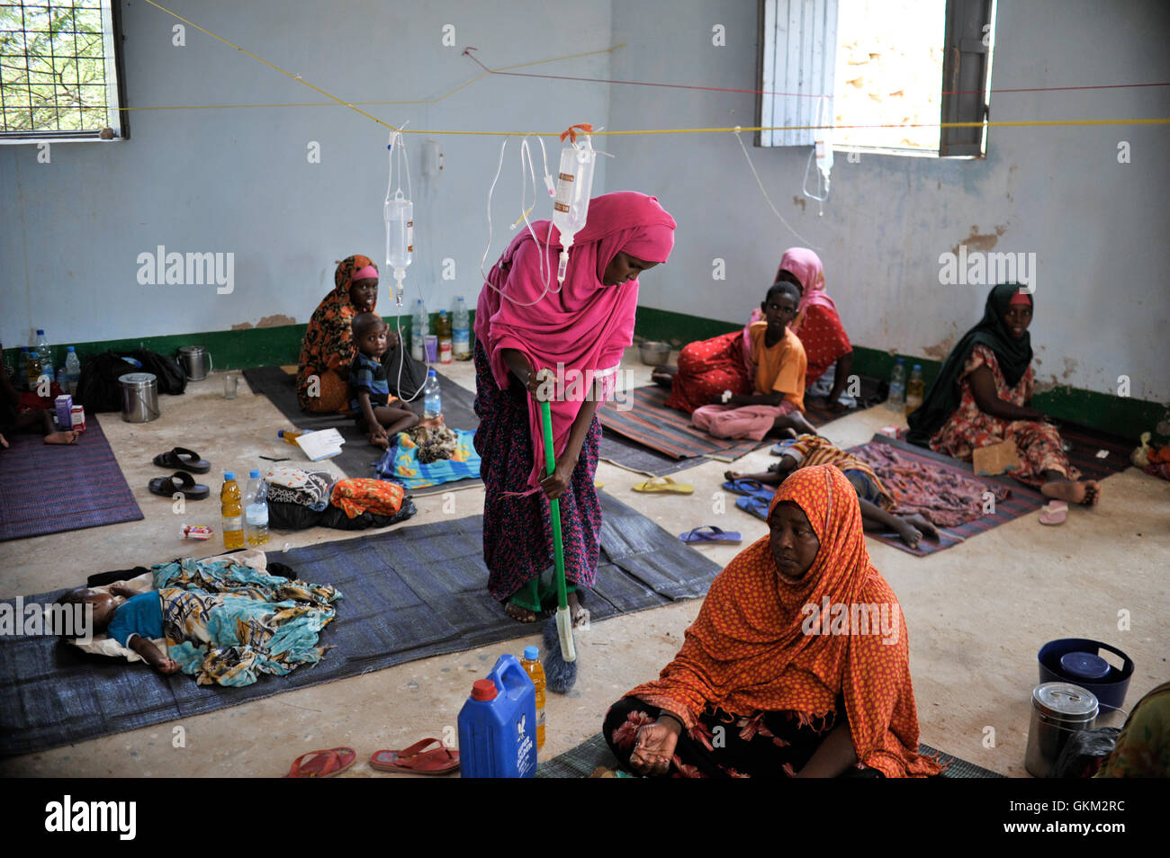 A woman sweeps the floor at a makeshift medical clinic in the city of Belet Weyne, Somalia, on March 30. A government Stock Photo