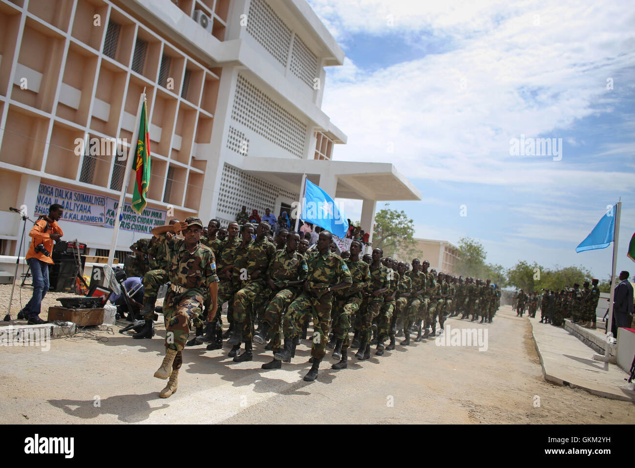 SOMALIA, Mogadishu: In photograph taken and released by the African Union-United Nations Information Support Team 12 April 2013, soldiers of the Somali National Army march during a military parade marking the 53rd Anniversary of the SNA held at the newly refurbished Ministry of Defence in the Somali capital Mogadishu. Somalia is rebuilding it's army, along with many state institutions and facilities after being racked by years of internal conflict and division and is enjoying it's longest period of relative peace since major operations by the SNA supported by forces of the African Union Missio Stock Photo