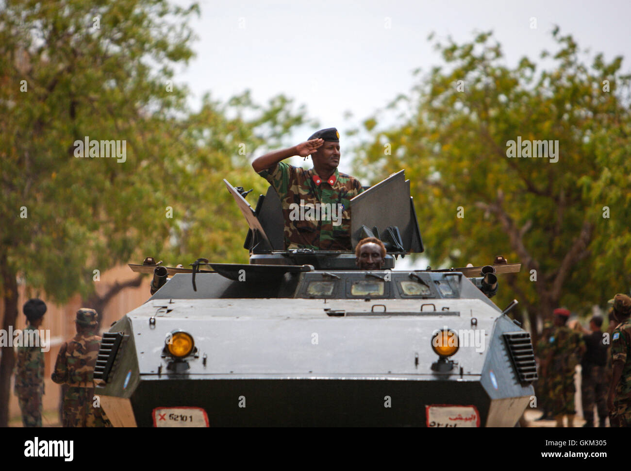 SOMALIA, Mogadishu: In photograph taken and released by the African Union-United Nations Information Support Team 12 April 2013, a gunner of an armoured personnel carrier of the Somali National Army salutes during a military parade marking the 53rd Anniversary of the SNA held at the newly refurbished Ministry of Defence in the Somali capital Mogadishu. Somalia is rebuilding it's army, along with many state institutions and facilities after being racked by years of internal conflict and division and is enjoying it's longest period of relative peace since major operations by the SNA supported by Stock Photo