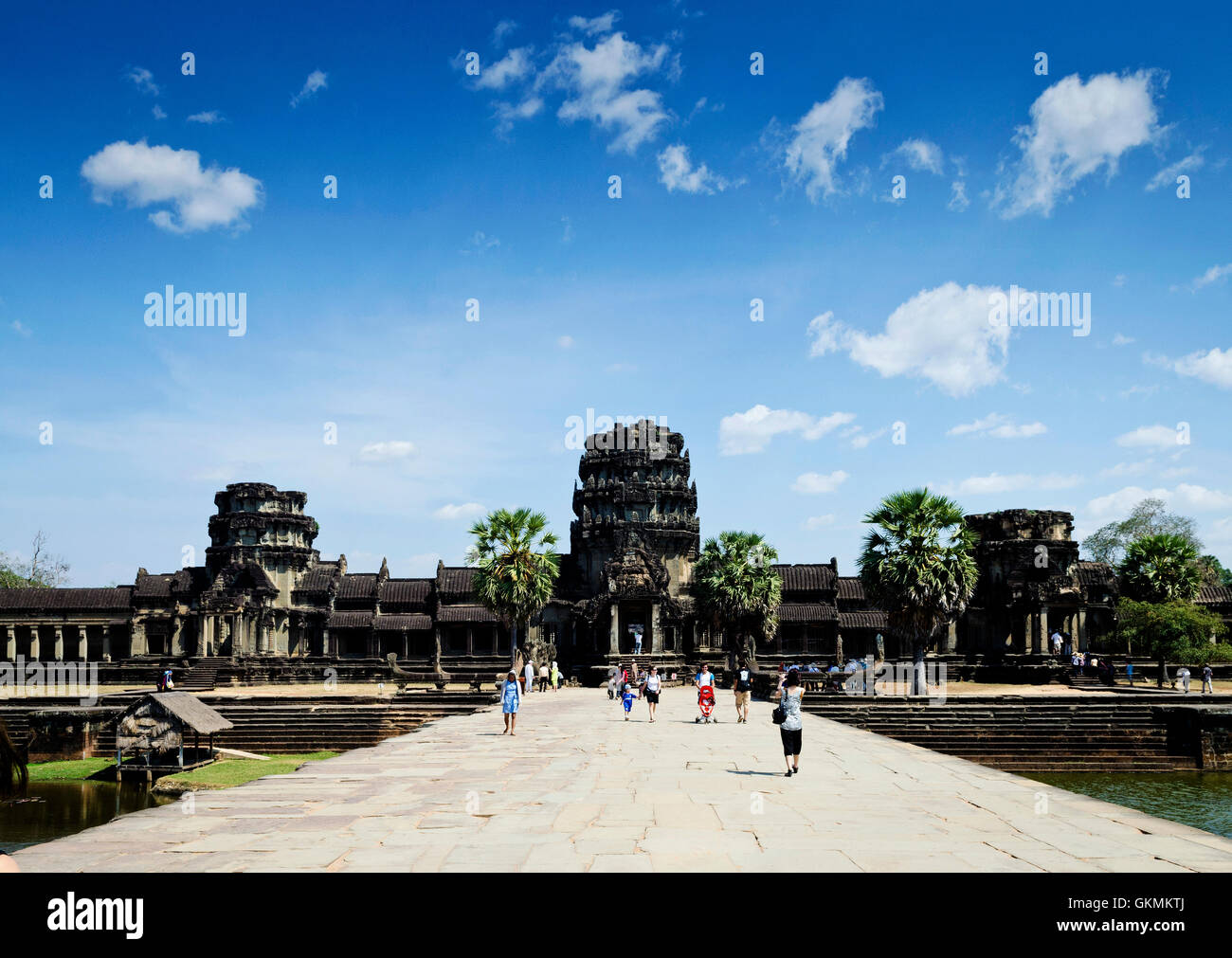 tourists at main entrance of angkor wat temples famous asian landmark in siem reap cambodia - Stock Image