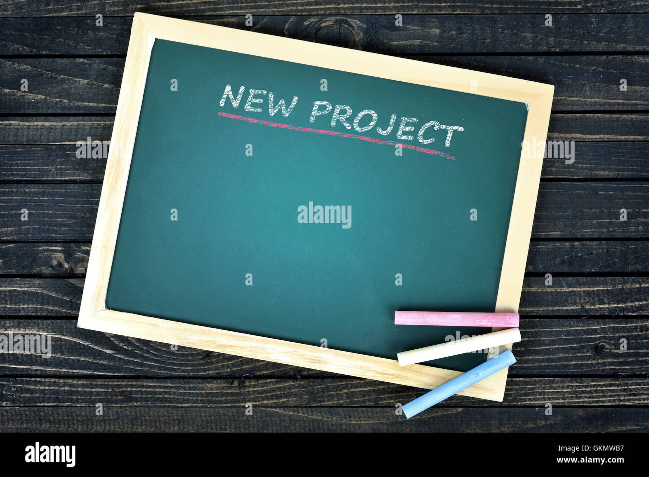 New project text on school board and chalk - Stock Image
