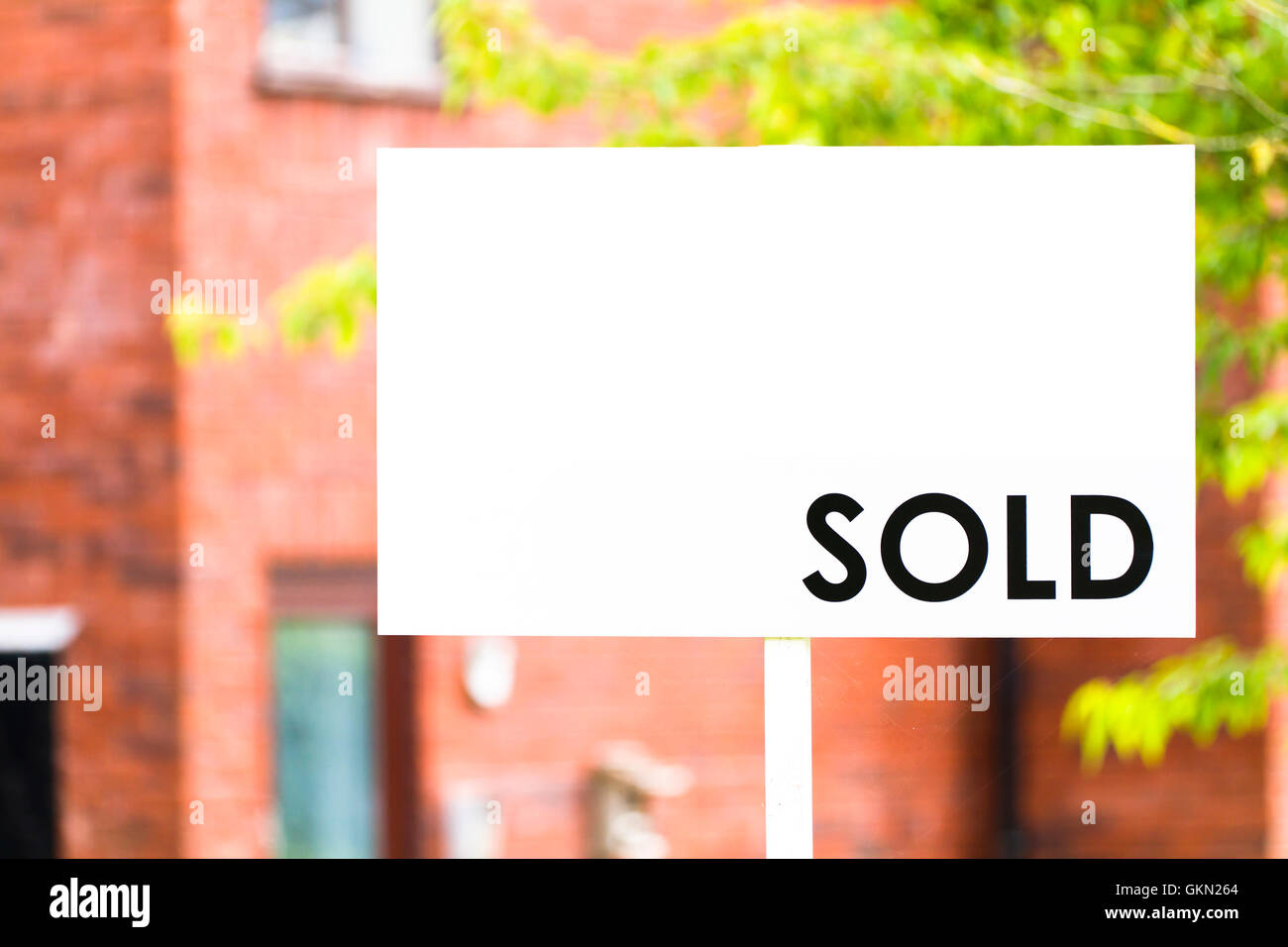 Estate agent house sold sign with shallow depth of focus - Stock Image