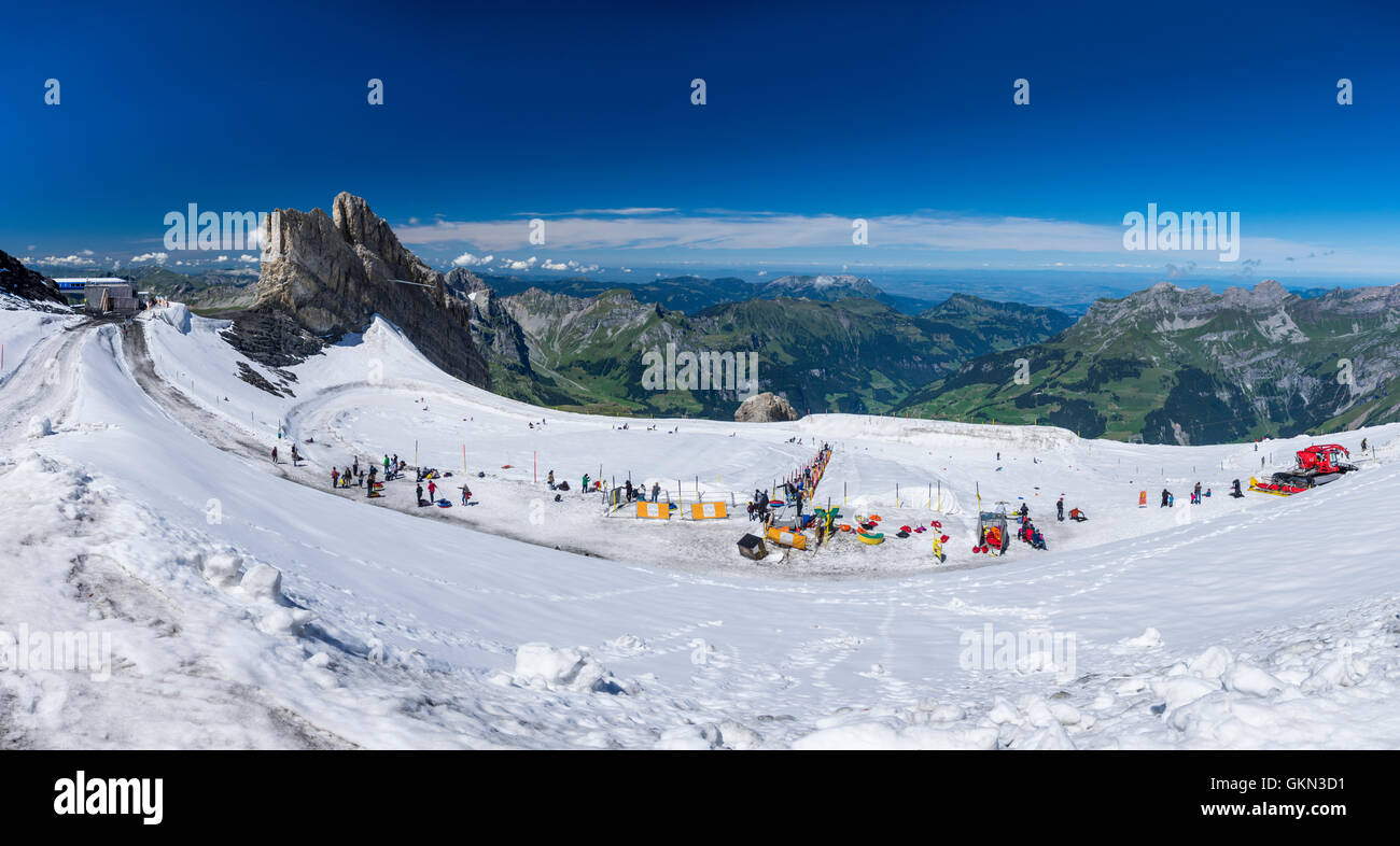 Panorama of the glacier park on Titlis glacier with various snow toys to try out during summer. Engelberg, Switzerland. Stock Photo
