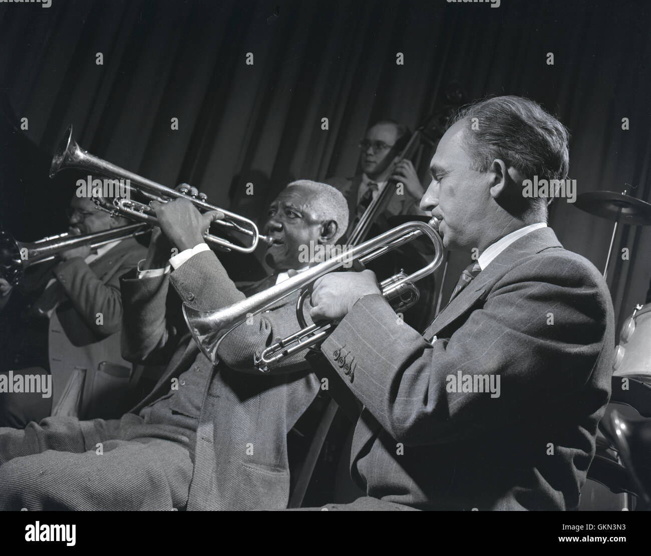 Bunk Johnson with the Doc Evans' band. Doc Evans is on trumpet, Don Thompson on trombone, and Cliff Johnson on bass. - Stock Image