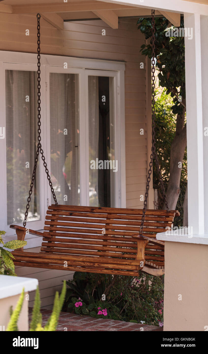 Irvine, CA, USA – August 19, 2016: Wood porch swing and feng shui ...