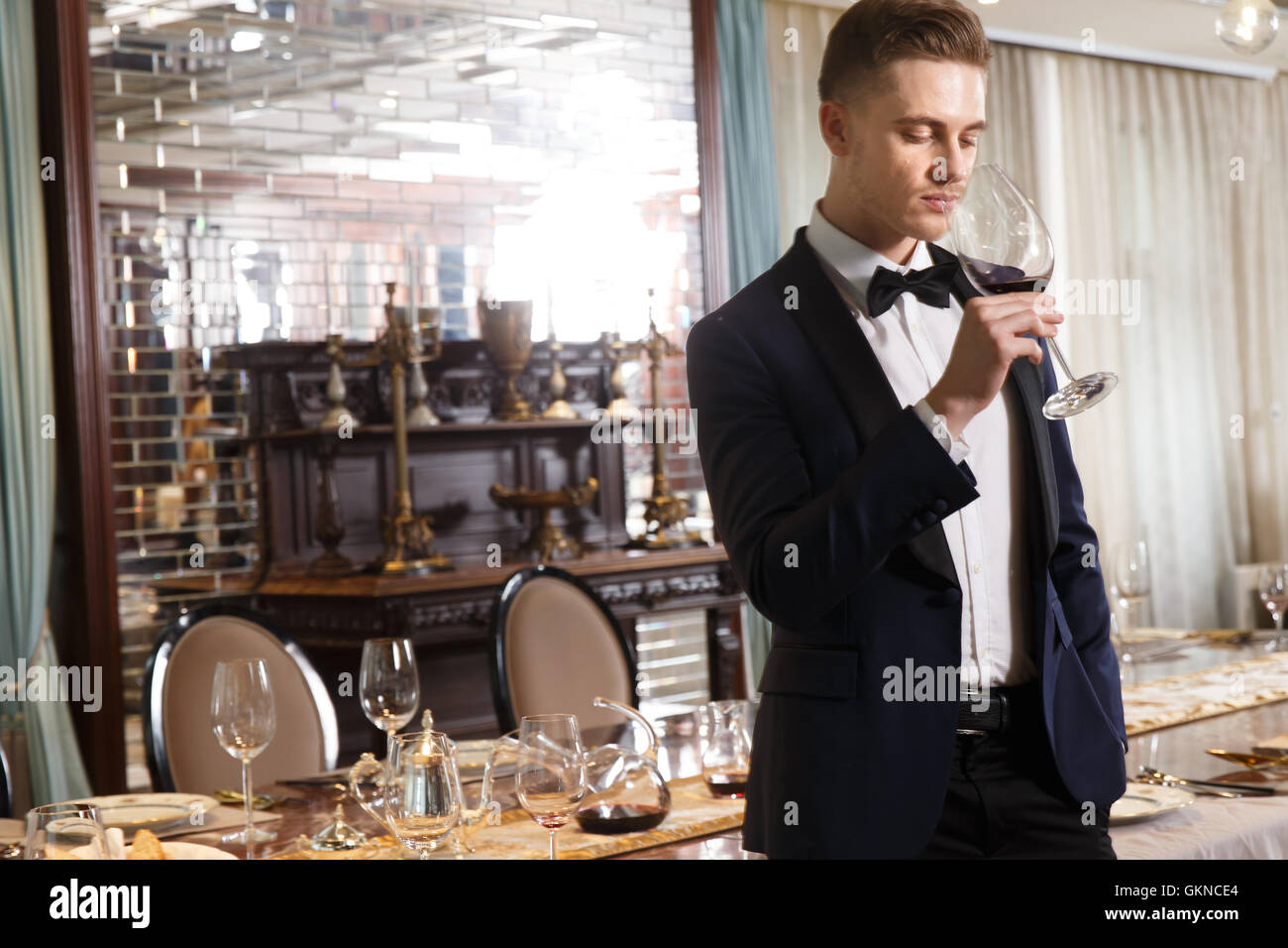 Young men drinking red wine - Stock Image