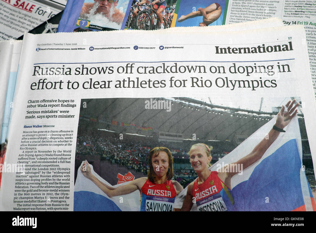 Guardian newspaper article headline   'Russia shows off crackdown on doping in effort to clear athletes for - Stock Image