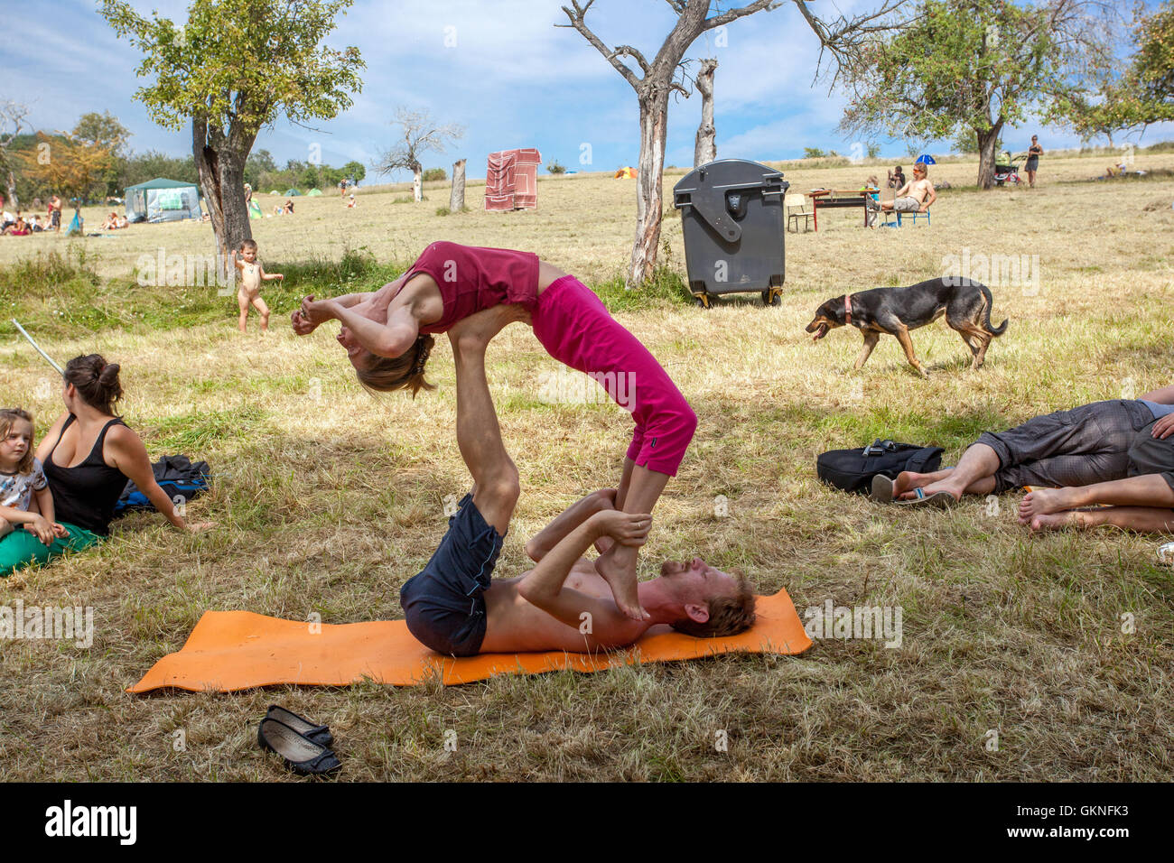 Practicing yoga in a summer meadow, Czech Republic - Stock Image