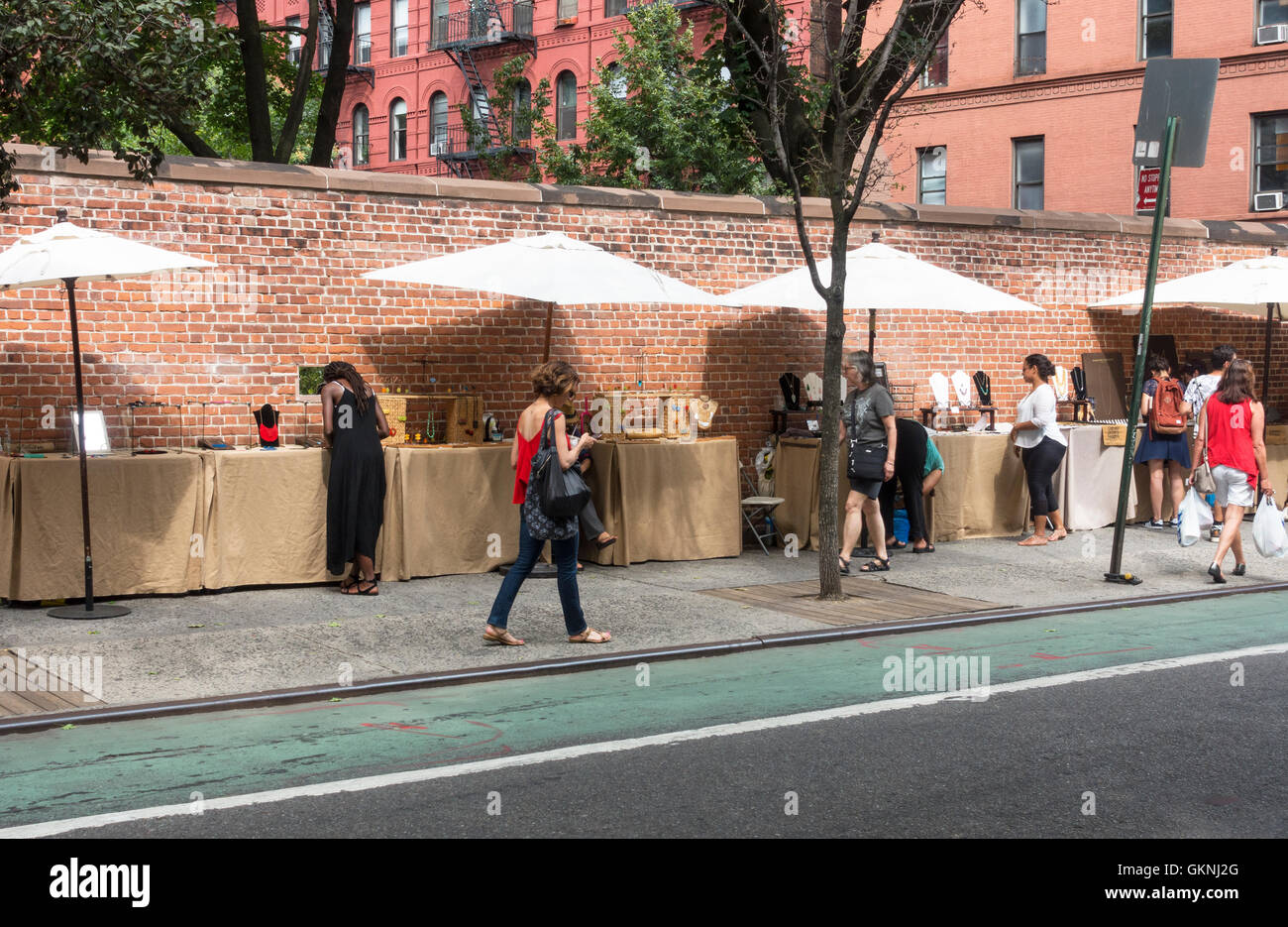 Outdoor stands selling collectibles on Prince Street in Nolita in New York City - Stock Image