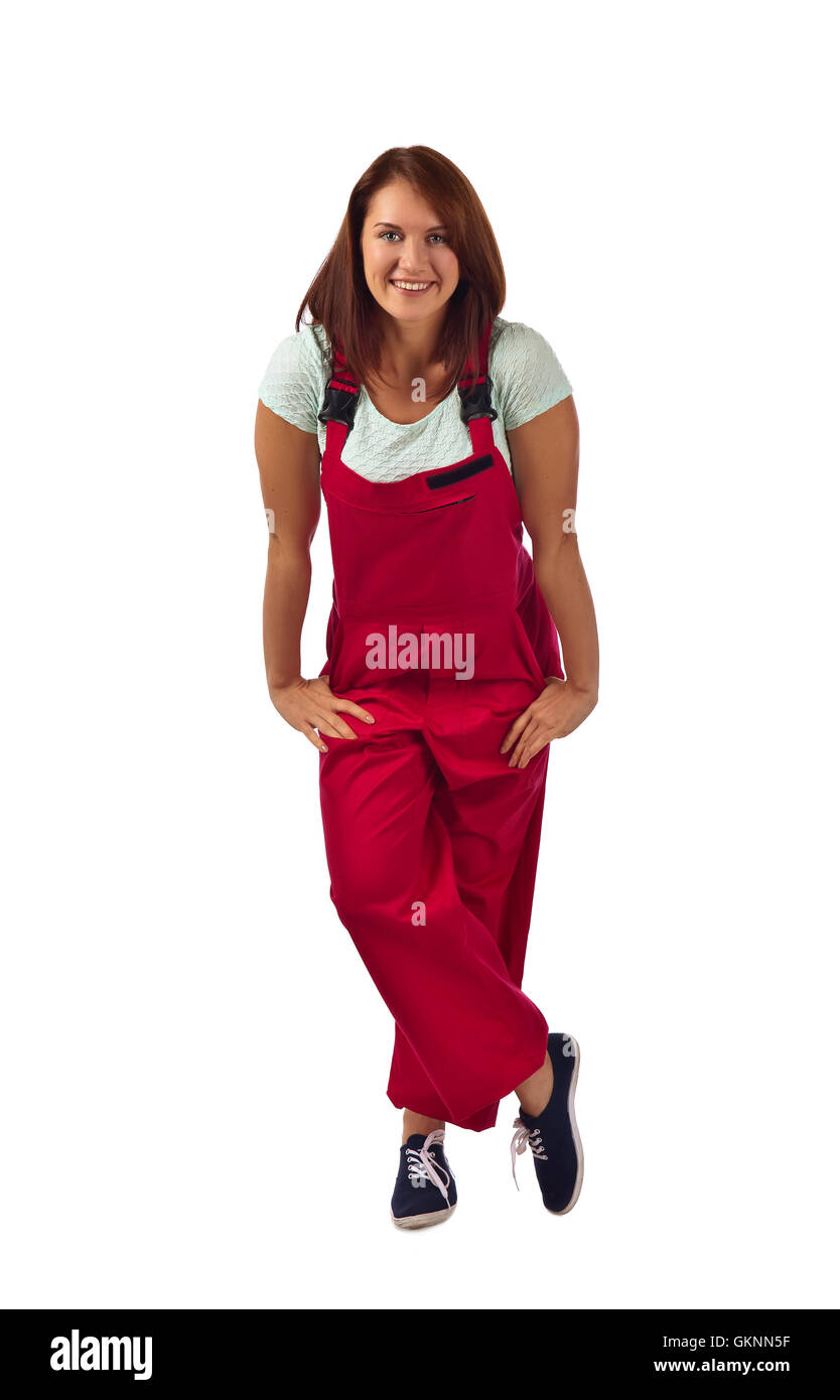 Young happy woman in red overalls  , isolated on a white background - Stock Image