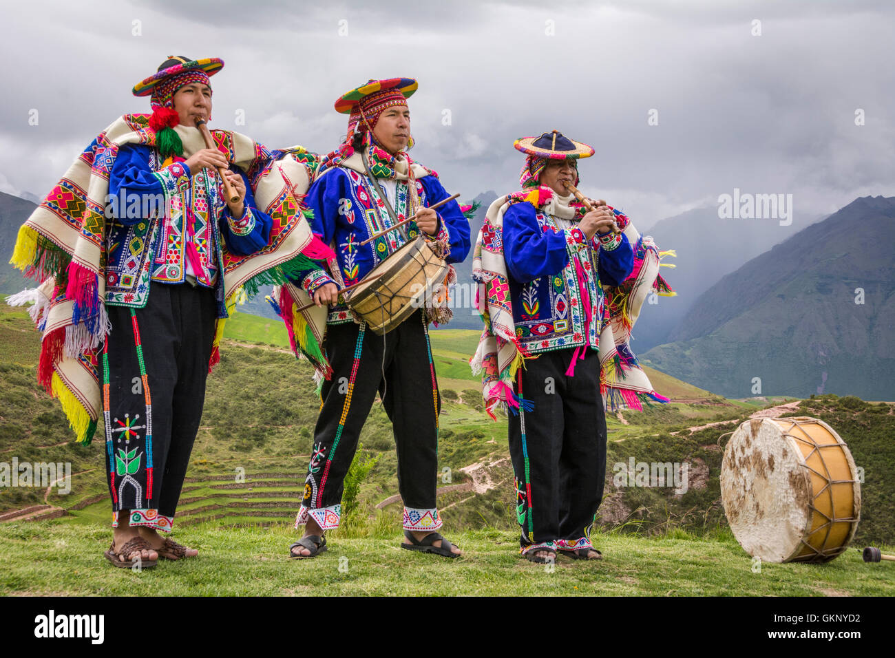 Quechua men in traditional clothing with musical instruments in performance at El Parador de Moray, Sacred Valley, - Stock Image