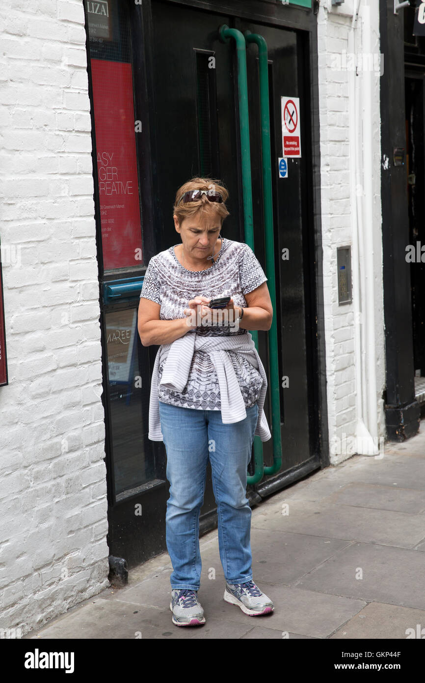 Greenwich,UK,21st August 2016,A lady checks a map on her mobile in Greenwich market,Londo Credit: Keith Larby/Alamy Stock Photo