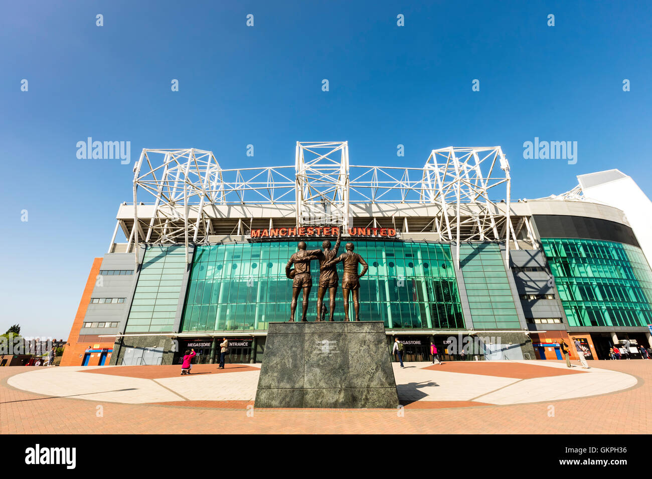 Old Trafford stadium is home to Manchester United one of the wealthiest and most widely supported football teams - Stock Image