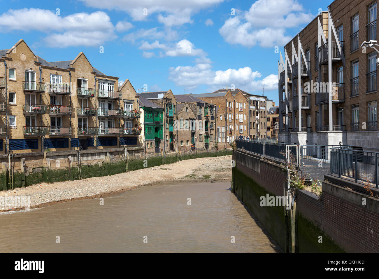 Old shipping warehouses on the Thames converted into residential apartment buildings, Canary Wharf / Limehouse, - Stock Image
