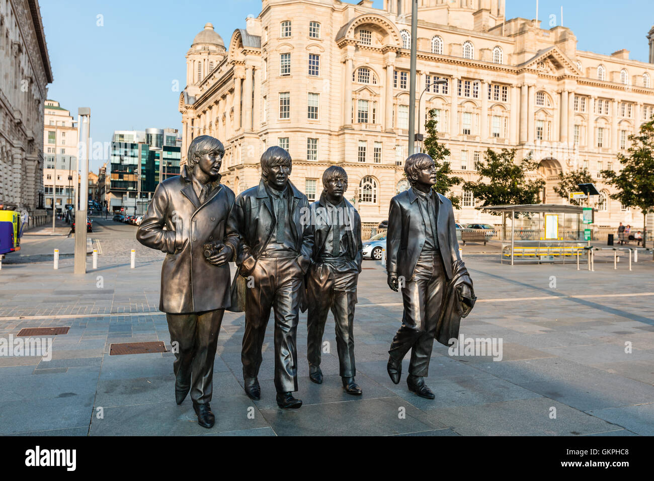 Bronze statue of the four Liverpool Beatles stands on Liverpool Waterfront by sculpture Andrew Edwards. - Stock Image