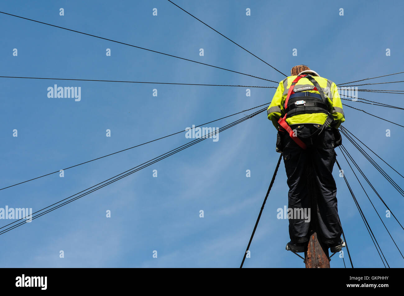 British telecoms engineer working on a telegraph pole in Bath city ...