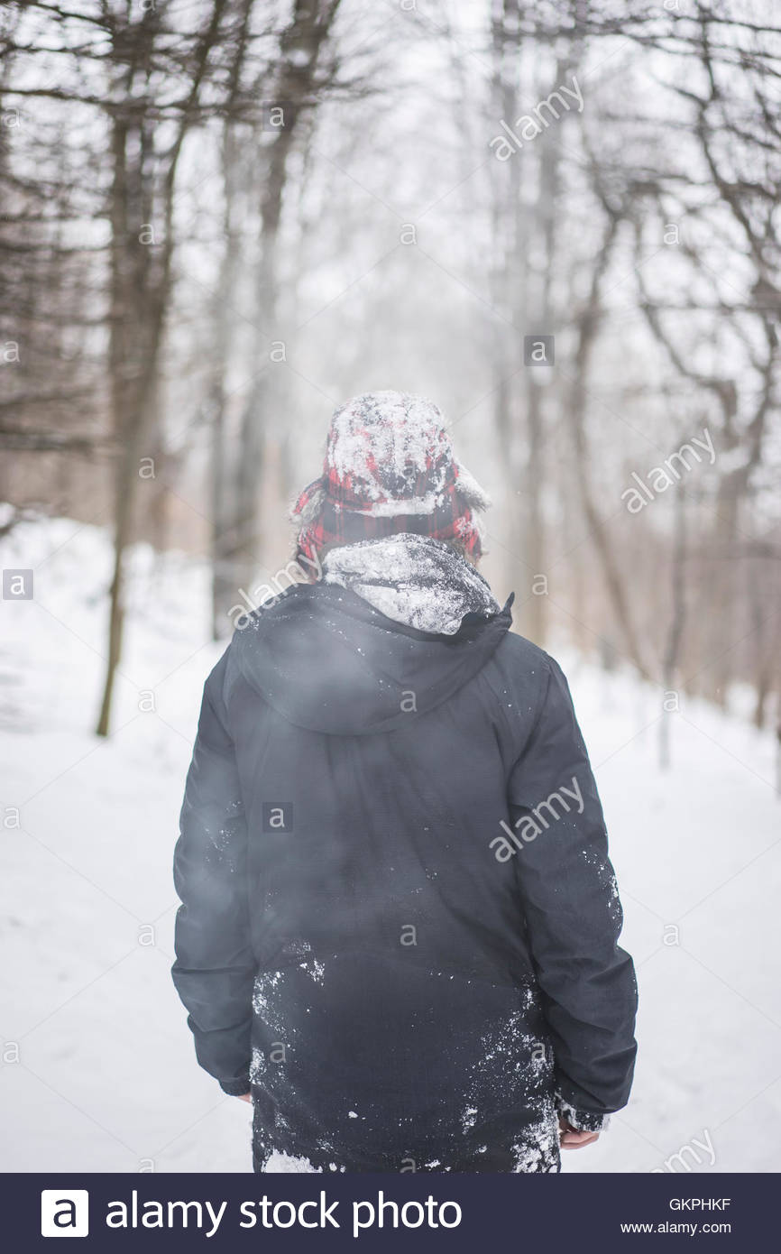Young man enjoying canadian winter in forest, Mont royal, Montreal, Quebec, Canada - Stock Image