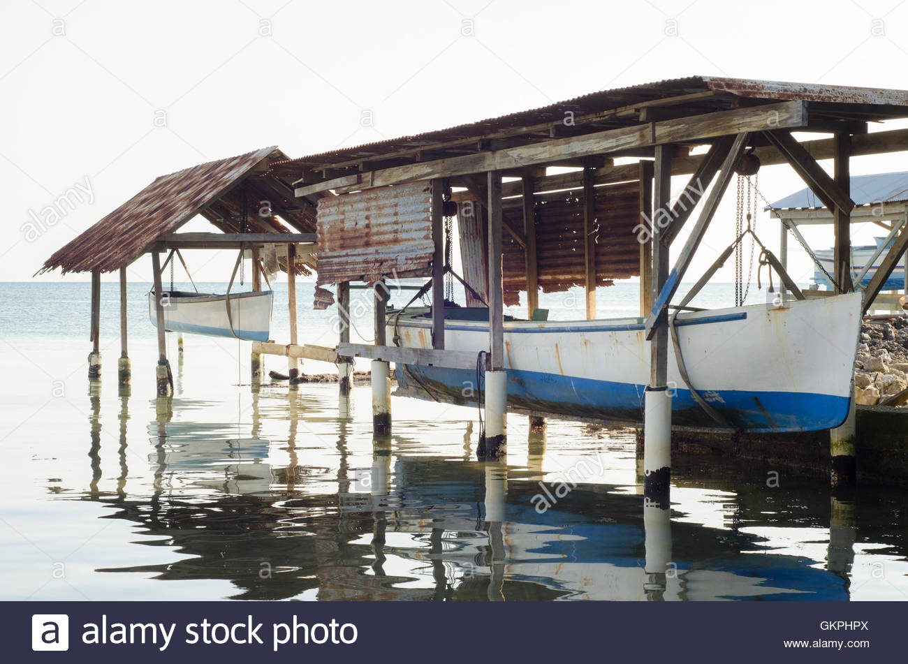 Huts for storing sailboats on ocean shore, central america Stock Photo