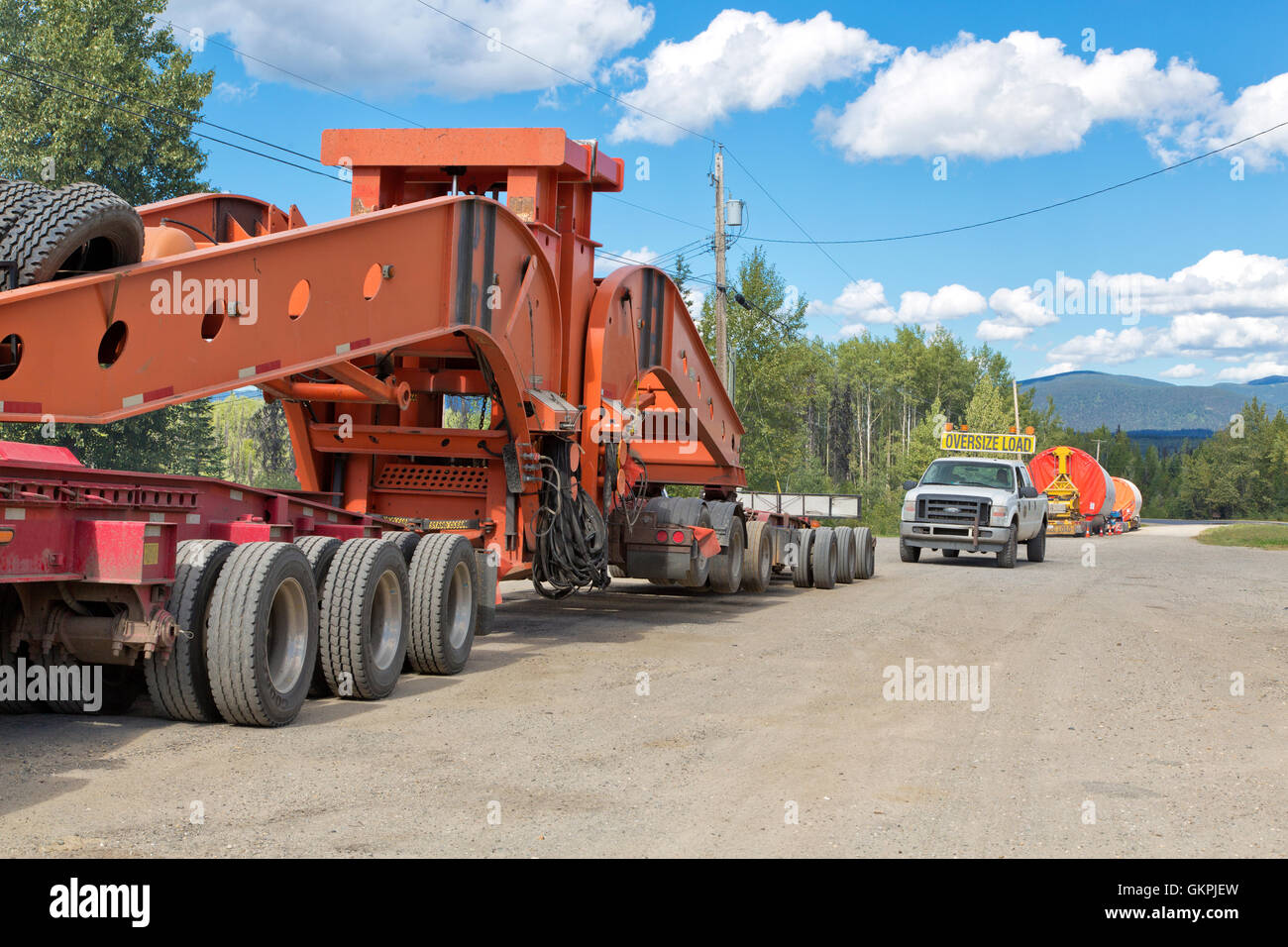 Transporting Wind Turbine towers, 'GE' , lead vehicle, heading for Tumbler Ridge. - Stock Image